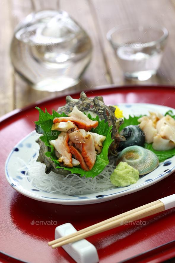 sazae ( horned turban shell ) sashimi, traditional japanese seafood dish - Stock Photo - Images