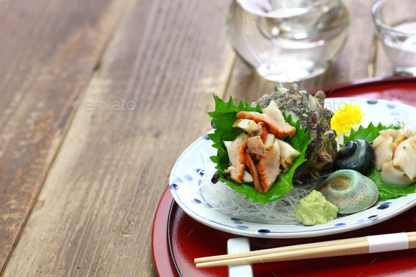 sazae ( horned turban shell ) sashimi, traditional japanese seafood dish - Stock Photo - Images