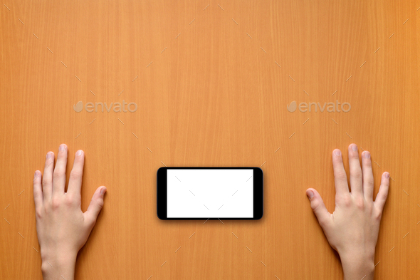 Smartphone and hands on table top view - Stock Photo - Images