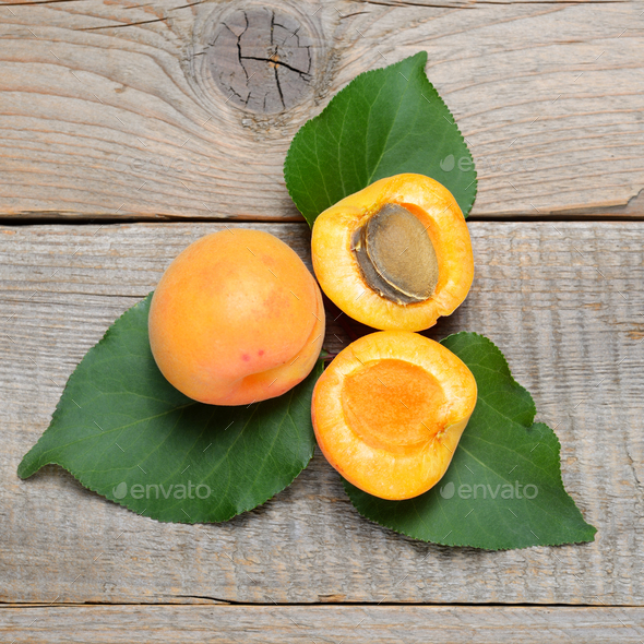 Fruits of apricot on wooden table - Stock Photo - Images