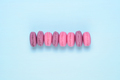 Pink macaroons on blue table - PhotoDune Item for Sale
