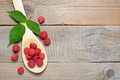 Raspberry in spoon on old wooden table - PhotoDune Item for Sale