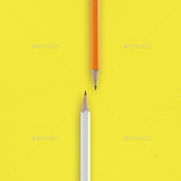 White and orange pencils on yellow background - Stock Photo - Images
