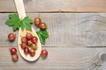 Gooseberry in spoon on old wooden table - PhotoDune Item for Sale