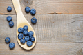 Blueberries in wooden spoon on table - PhotoDune Item for Sale