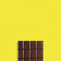Chocolate on yellow table top view - PhotoDune Item for Sale