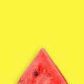 Watermelon slice on yellow background - PhotoDune Item for Sale