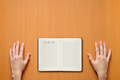 Hands and notepad with title To Do List on desk - PhotoDune Item for Sale