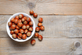 Hazelnuts on wooden table top view - PhotoDune Item for Sale