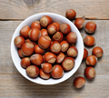 Hazelnuts close-up on wooden table - PhotoDune Item for Sale