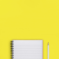 Notepad and pencil on yellow background top view - PhotoDune Item for Sale