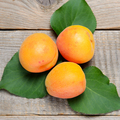 Apricots on wooden table close-up - PhotoDune Item for Sale