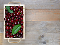 Cherry in box on wooden table top view - PhotoDune Item for Sale