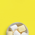 Marshmallow in bowl on yellow table top view - PhotoDune Item for Sale