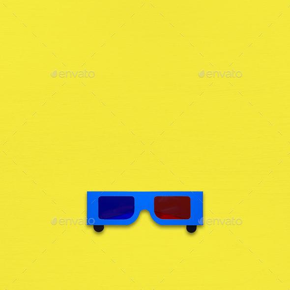 Paper anaglyph glasses on yellow background - Stock Photo - Images