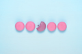 Macaroons in row on blue table top view - PhotoDune Item for Sale