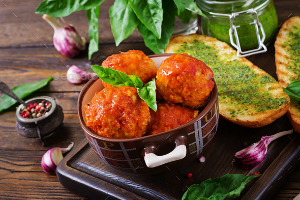 Meatballs in tomato sauce and toast with basil pesto. Dinner. Tasty food. - Stock Photo - Images