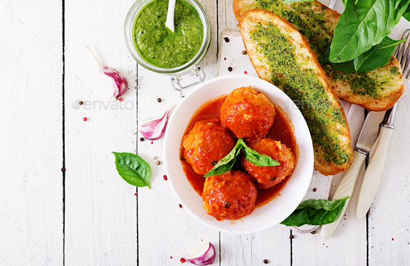 Meatballs in tomato sauce and toast with basil pesto. Dinner. Tasty food. Top view. Flat lay - Stock Photo - Images