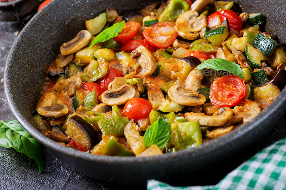 Hot spicy stew eggplant, sweet pepper, tomato, zucchini and mushrooms. - Stock Photo - Images