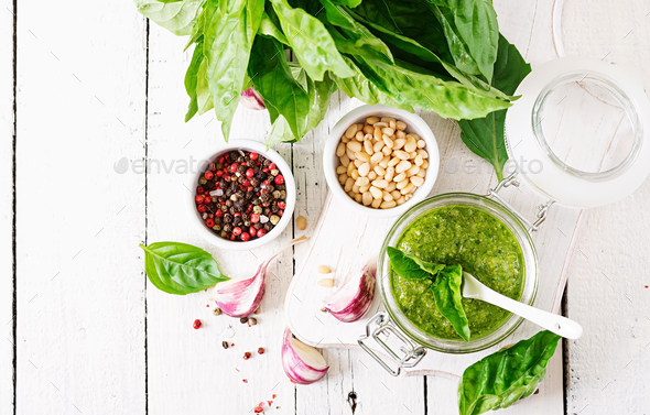 Homemade pesto sauce fresh basil, pine nuts and garlic on wooden background. - Stock Photo - Images