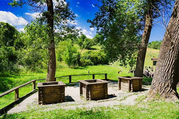 Three wells on the edge of the forest. Beautiful landscape - Stock Photo - Images