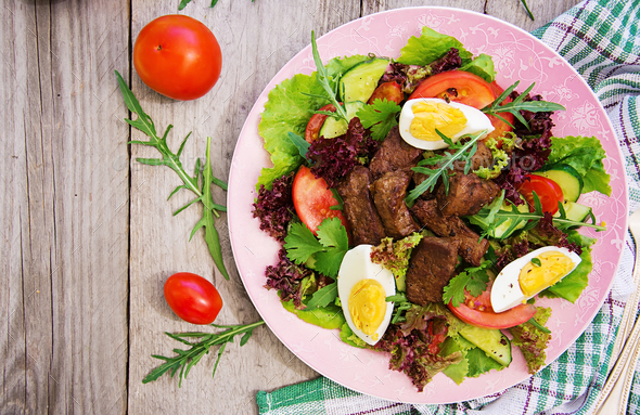 Meat salad with liver and fresh vegetables. Top view, Flat lay - Stock Photo - Images