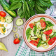 Breakfast in the summer garden. Salad of eggs and cucumbers with green onions and basil. - PhotoDune Item for Sale