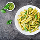 Penne pasta with  pesto sauce, zucchini, green peas and basil. Italian food. Top view. Flat lay. - PhotoDune Item for Sale