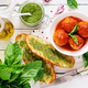 Meatballs in tomato sauce and toast with basil pesto. Dinner. Tasty food. Top view. Flat lay - PhotoDune Item for Sale