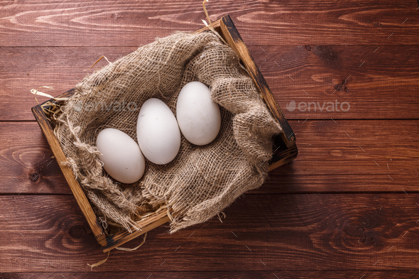 Three big fresh goose eggs in a box, copyspace - Stock Photo - Images