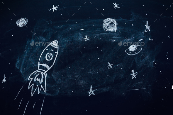 Space rocket doodle drawing on chalkboard - Stock Photo - Images