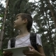 Boy Traveler Uses a Tablet in the Forest, Checks the Route By Navigator - VideoHive Item for Sale