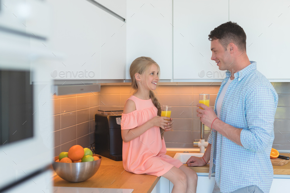 Father and daughter having breakfast - Stock Photo - Images