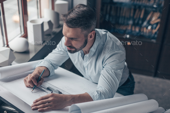 Mature professional at work - Stock Photo - Images
