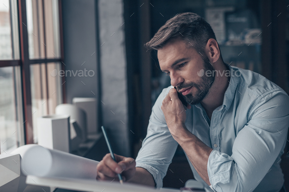 Mature architect talking on the phone - Stock Photo - Images