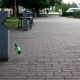 Man Walks Down the Street and Throws a Plastic Bottle By the Garbage - VideoHive Item for Sale