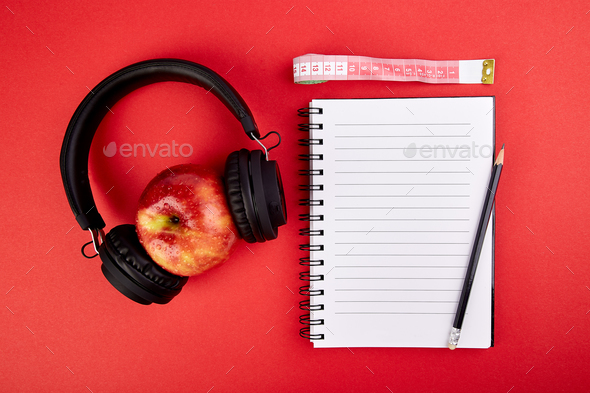 Black Headphones and apple - Stock Photo - Images