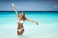 Happy girl enjoying day on the beach - PhotoDune Item for Sale