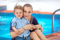 Baby boy with mom on the beach resort - PhotoDune Item for Sale