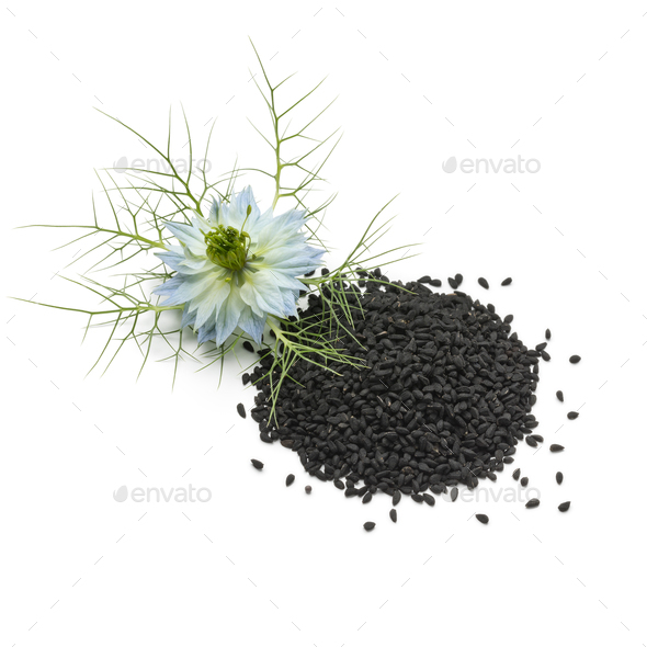 Heap of black nigella seeds and flower - Stock Photo - Images