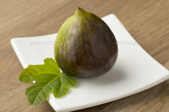 Fresh ripe fig on a dish - Stock Photo - Images