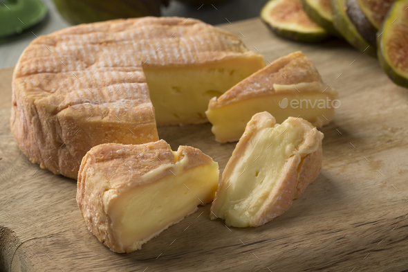 Petit Munster cheese and wedges close up - Stock Photo - Images