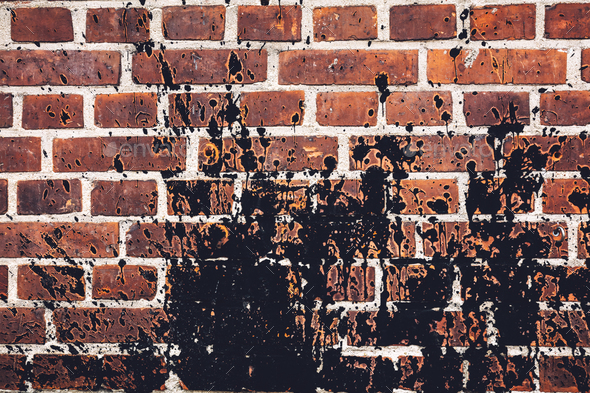 Black paint spilled all over red brick wall. - Stock Photo - Images