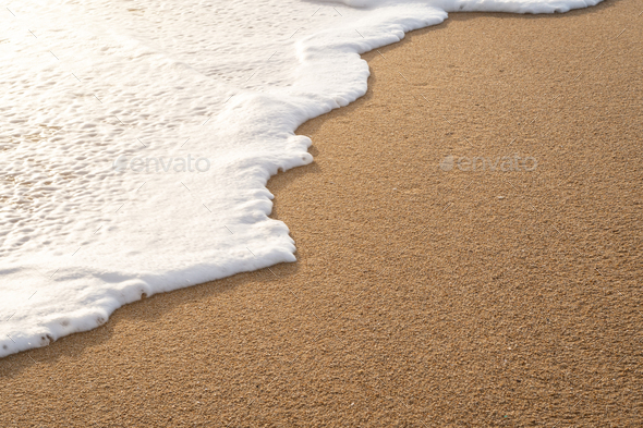 Soft wave on sandy beach - Stock Photo - Images