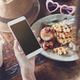 Young woman using smart phone and enjoy eating dessert in cafe - PhotoDune Item for Sale