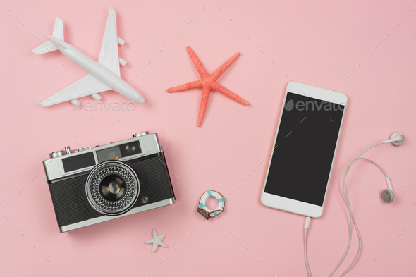Retro camera with toy plane on pastel pink background and empty screen smart phone - Stock Photo - Images