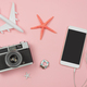 Retro camera with toy plane on pastel pink background and empty screen smart phone - PhotoDune Item for Sale