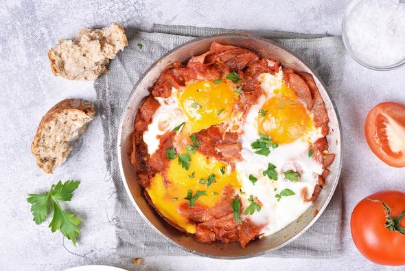 Fried eggs with bacon in frying pan - Stock Photo - Images