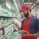 Handsome Male Merchandiser Checking Milk Products with Digital Tablet - VideoHive Item for Sale
