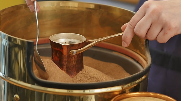 Preparation of Turkish Coffee in Copper Cezve on the Hot Sand by FancyStudio